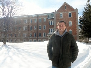 Dustin standing by Koons Hall, home to the Doctor of Physical Therapy program he will attend starting this summer.