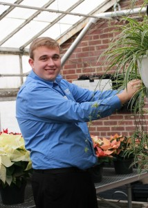 Kamil in the greenhouse