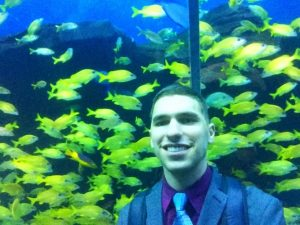 Danny in front of fish