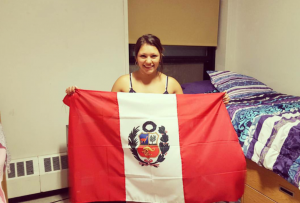 Me, sophomore year, holding the Peruvian flag.