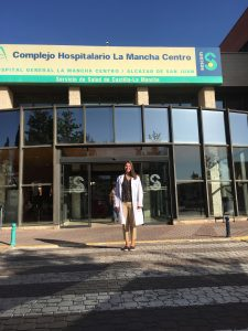Emily in front of the hospital she shadowed in on her trip to Spain.