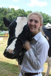 Ambassador Katy and Desire, her first dairy cattle 4-H project at the local 4-H Fair